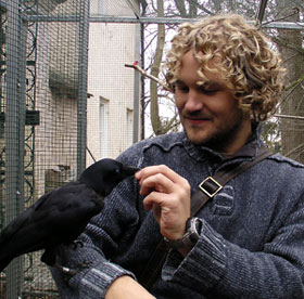 Me and Uek, a hand-raised NC crow living with Auguste von Bayern at her research station in Germany
