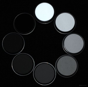 This photo shows a set of grey standards we use to linearise cameras, with reflectance values ranging from 2% to 99%. They are made a spectralon - one of the most diffuse substances known - basically non-stick plastic that's been powdered and squished together with a bit of heat (sintered), then mixed with charcoal to get the grey level.